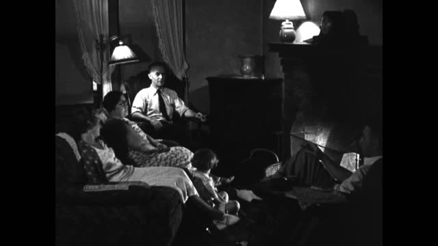 two men are shown individually sitting, listening and smoking cigars / another couple sits in their living room / the man smoking a pipe with his... - franklin roosevelt stock videos & royalty-free footage