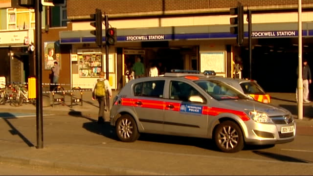 two men arrested following stockwell shooting england london stockwell ext various shots of police cars and police officers in cordonedoff road... - stockwell stock videos and b-roll footage