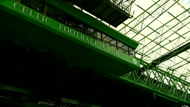 Two men arrested in Celtic manager parcel bomb case Celtic Park General view of empty stands and pitch of Celtic Park stadium Reporter to camera...