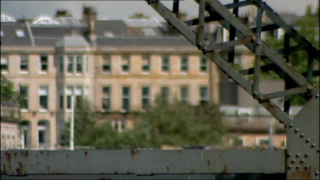 two men arrested in celtic manager parcel bomb case; scotland: glasgow: ext **good shots** glasgow skyline with river clyde and former dockyard crane... - steeple stock videos & royalty-free footage