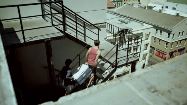 Two men arriving on rooftop party