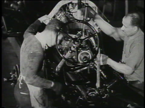 b/w 1932 two men assembling car in ford factory - ford motor company stock videos and b-roll footage