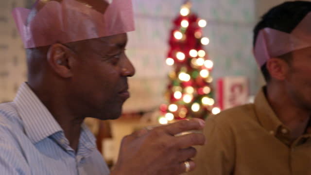 two men at christmas dinner - christmas decoration stock videos & royalty-free footage