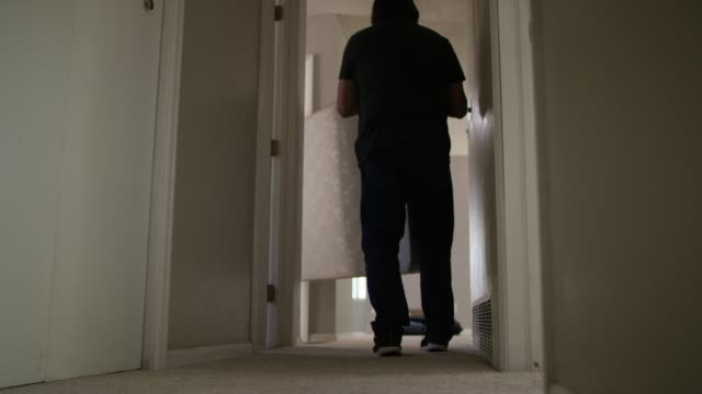 two men carry a mattress down a hallway - picking up stock videos & royalty-free footage