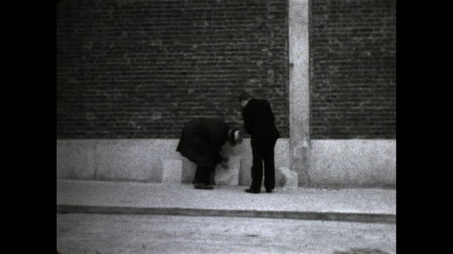 two men do target practice in street alley. - masculinity stock videos & royalty-free footage