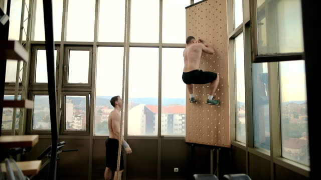 two men doing climbing exercise - clambering stock videos & royalty-free footage