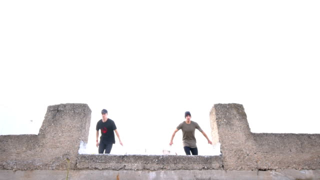 two men doing free running parkour - agility stock videos & royalty-free footage