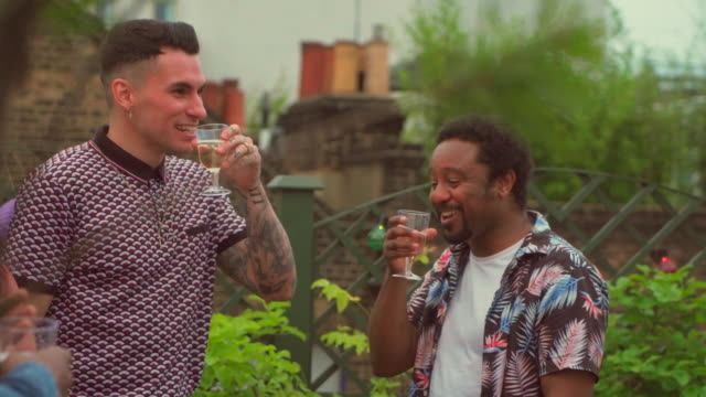 two men drink champagne - male friendship stock videos & royalty-free footage