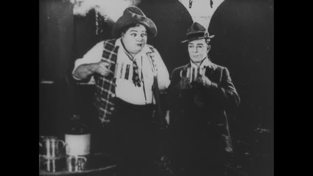 1918 Two men (Fatty Arbuckle and Buster Keaton) drink moonshine