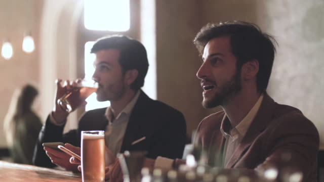 two men drinking beer in a bar - rustic stock videos & royalty-free footage