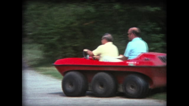 1976 two men drive around in six wheel buggy - 1976 stock videos and b-roll footage