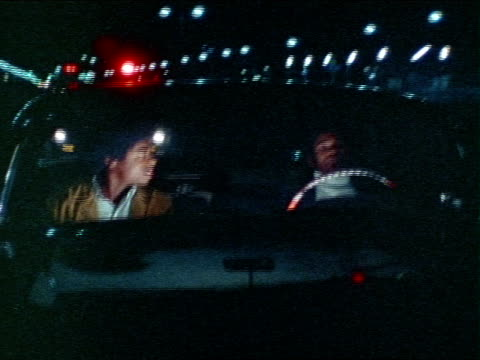 1971 montage two men driving and being pulled over by police / los angeles, california / audio - 1971 stock-videos und b-roll-filmmaterial