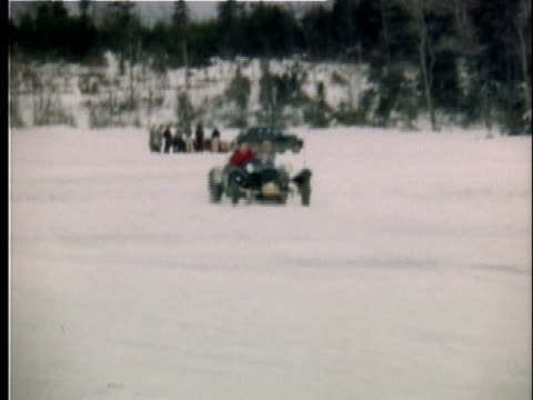 1951 pan two men driving vintage sport car on snow, vermont, usa, ms - 1951 stock videos & royalty-free footage