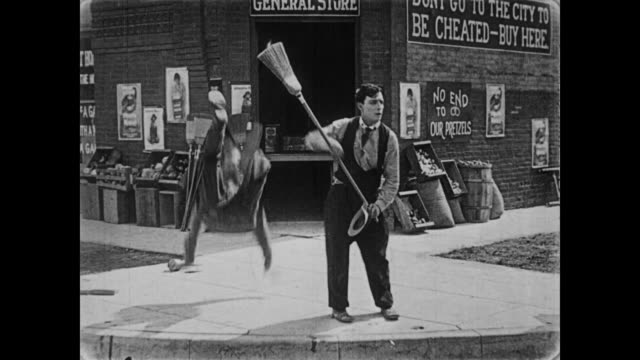 vidéos et rushes de 1919 two men enter general store after fighting outside - 1910 1919