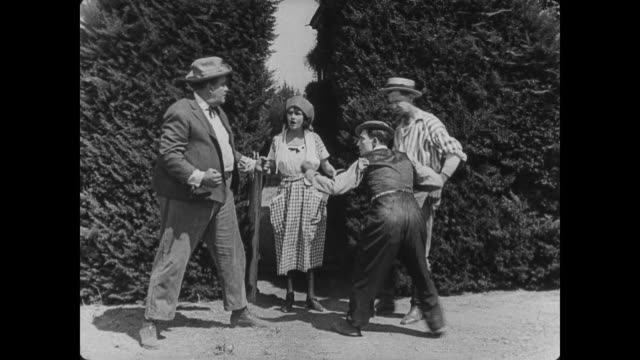 1920 two men (buster keaton and joe roberts) fight over pretty neighbor (sybil seely) - nachbar stock-videos und b-roll-filmmaterial