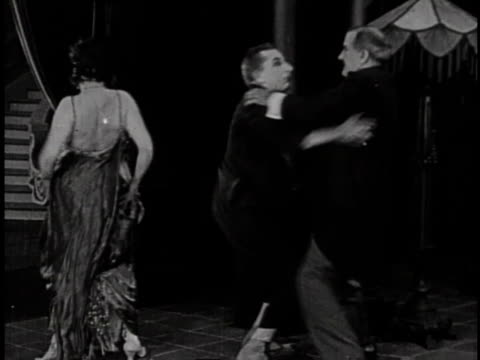 1920 montage two men fight with another man then throw him out of the house after catching him with his hand down a woman's dress - larry semon stock videos and b-roll footage