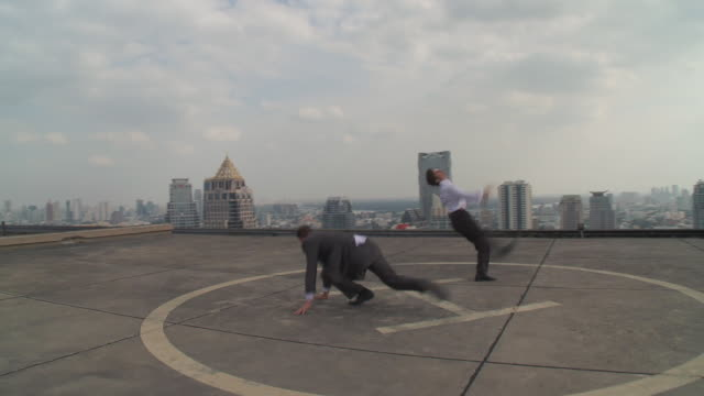 ws zi two men fighting on rooftop / bangkok, bangkok, thailand - suit stock videos & royalty-free footage