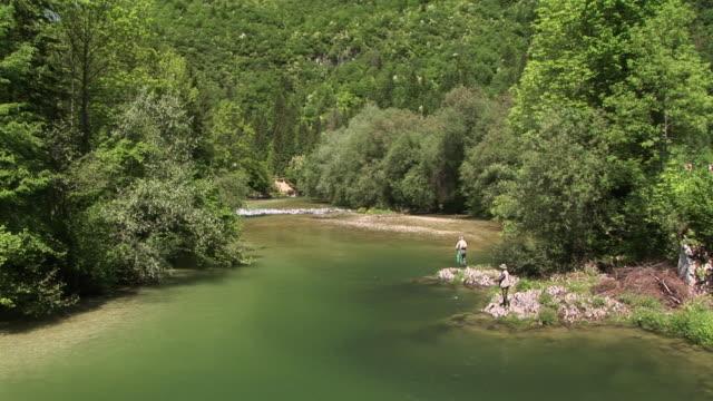 ws, ha, two men fishing on sava bohinjka riverbank, triglav national park, slovenia - triglav national park stock videos and b-roll footage