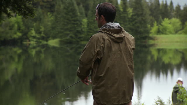 ms pan td, two men fly fishing by lake, morristown, vermont, usa - vermont stock videos & royalty-free footage