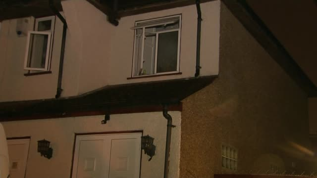 two men found dead following carbon monoxide leak in harrow; england: london: harrow: ext / night police van parked in driveway open windows wide... - harrow stock videos & royalty-free footage