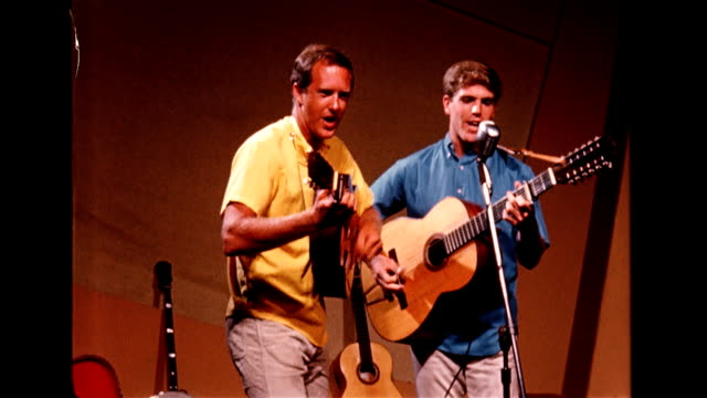 / two men from The Other Singers group entertain the crowd at the Troubadour café play guitar and sing for crowd Musicians entertain at the...