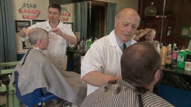 ms two men getting hair cut at old style barber shop / rutland, vermont, usa - electric razor stock videos and b-roll footage