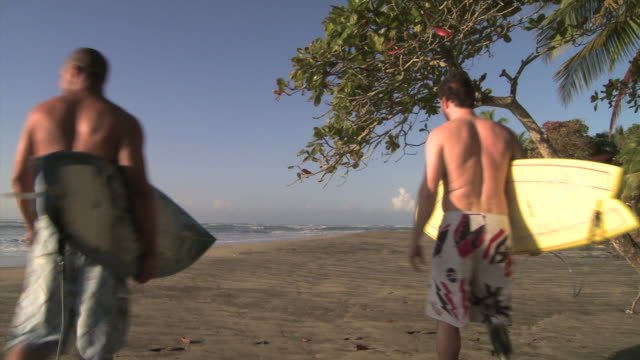 two men going to surf - see other clips from this shoot 1157 stock videos & royalty-free footage