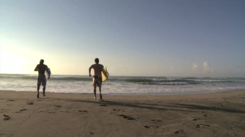 two men going to surf - real time stock videos & royalty-free footage