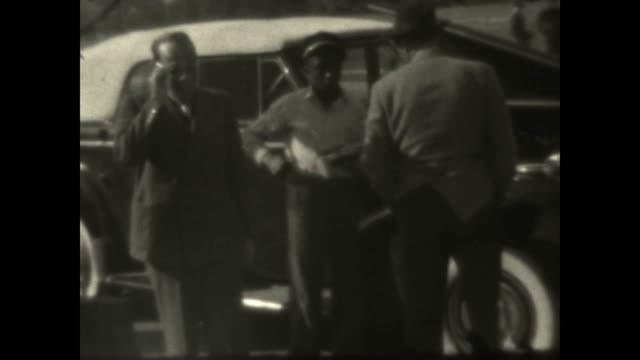 two men have their car serviced at a gulf oil station on the approach to atlantic city - filling station attendant stock videos and b-roll footage