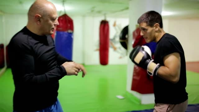 Two men having boxing workout indoors