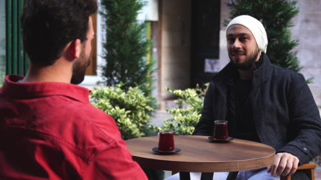 two men having talk and drinking turkish tea in cafe - turkish ethnicity stock videos & royalty-free footage