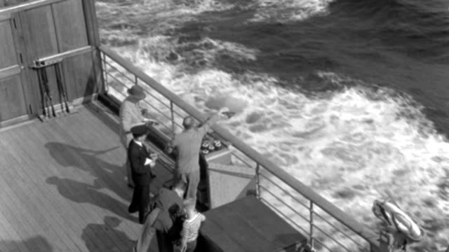 two men in 1937 trap shoot at the rail of an ocean liner's sports deck. - 1937 stock videos & royalty-free footage