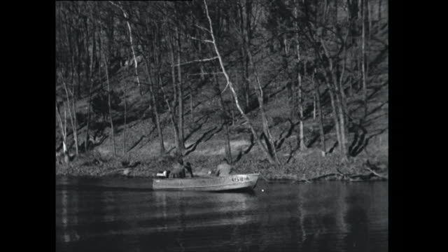 two men in a fishing boat - 1961 stock videos & royalty-free footage