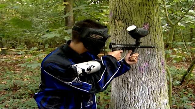 Two men in court following raid on Chinese restaurant Berkshire Man wearing protective mask firing paintball gun Man behind tree firing paintball gun...