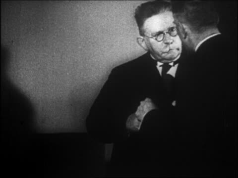stockvideo's en b-roll-footage met two men in hitler's cabinet talking / hitler just appointed chancellor - 1933