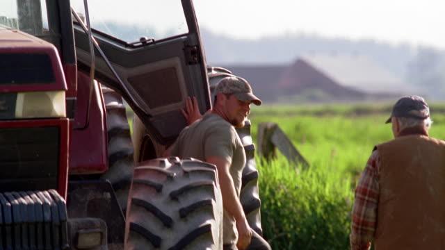 MS, PAN, Two men in rural landscape