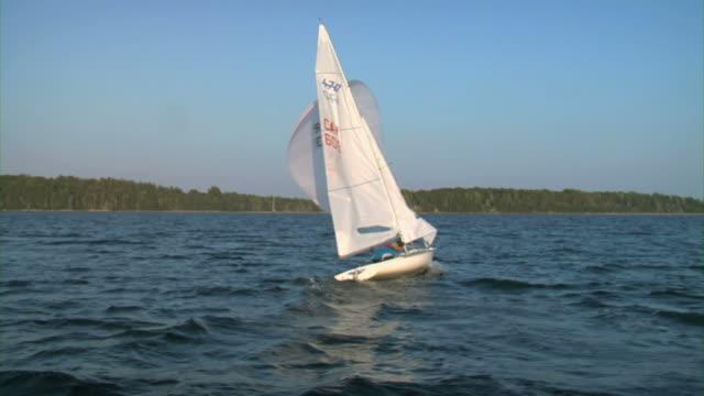WS DS POV Two men in sailboat sailing through sea / Chester, Noviscocia, Canada