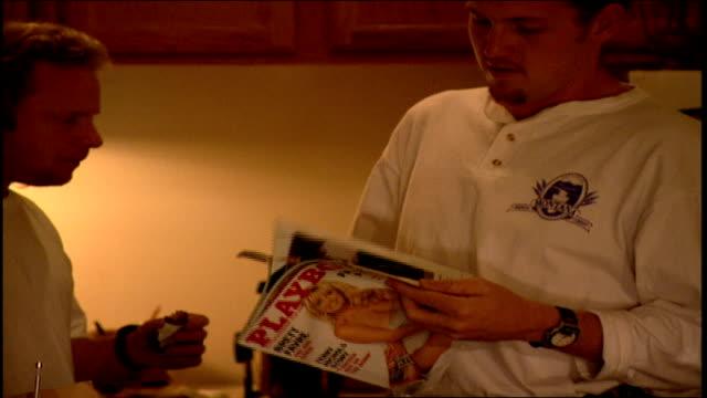 two men looking through a playboy magazine - magazine stock videos & royalty-free footage