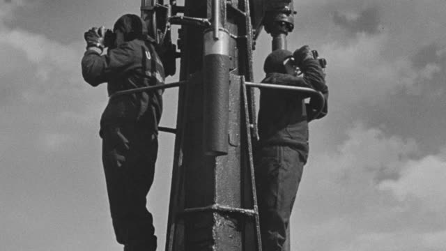 MS Two men lookouts on deck of submarine