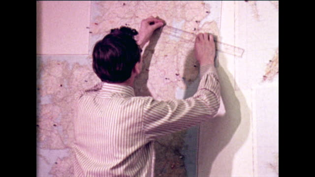 two men measuring distances on large wall maps; 1973 - instrument of measurement stock videos & royalty-free footage