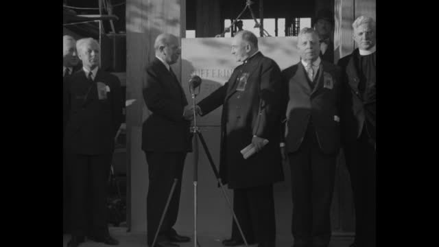 two men mount cornerstone for display / illinois governor henry horner on left and catholic bishop james griffin standing in front of cornerstone... - griffin stock videos & royalty-free footage