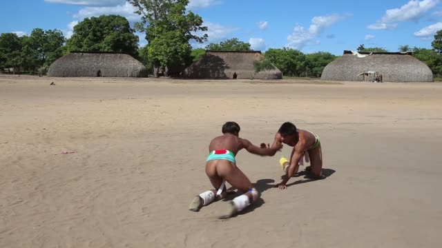 TS Two men of the Kamayura tribe battle in a match of traditional Huka Huka wrestling shot on June 14th 2014
