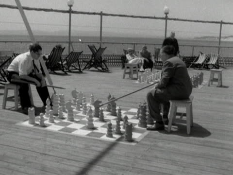 two men play chess on bournemouth pier - bournemouth england stock videos & royalty-free footage