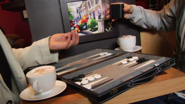vídeos de stock, filmes e b-roll de ms two men playing backgammon in coffee shop/ vancouver, bc - kelly mason videos