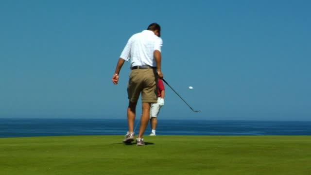 vídeos y material grabado en eventos de stock de ms, two men playing golf, north truro, massachusetts, usa - golf