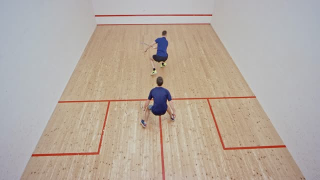 two men playing squash in a new court - squash sport stock videos & royalty-free footage