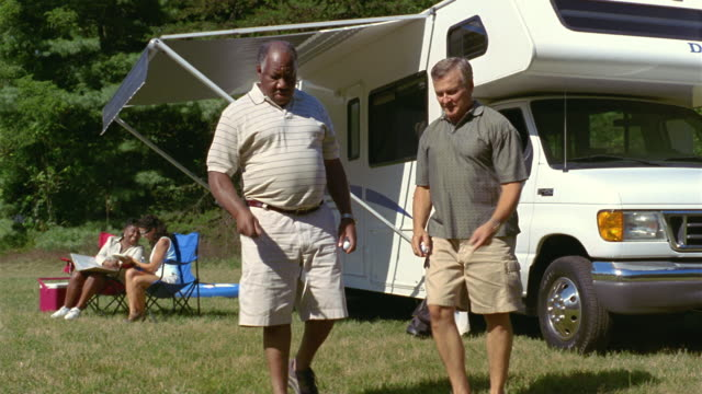 ms two men practicing golf swings next to parked motor home / asheville, north carolina, usa - golf swing women stock videos & royalty-free footage