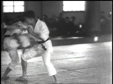 vídeos de stock, filmes e b-roll de 1939 ts two men practicing martial arts / japan - karate