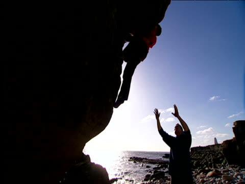 Two men practise bouldering