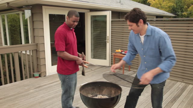 ms two men preparing porch barbecue / portland, oregon, united states - front stoop stock videos and b-roll footage